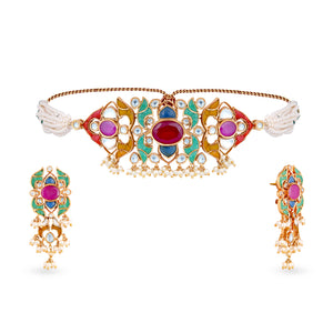 High end finish uncut kundan choker and earrings set with synthetic polkis cladded in pure silver casing centered with Hydrothermal ruby along with green onyx stones. This is such a pretty and dainty choker and will elevate absolutely any look