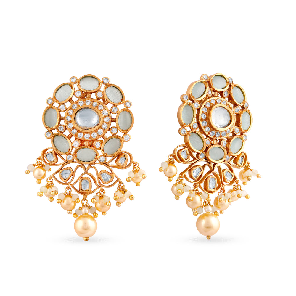 Gold plated kundan stud earrings carefully handcrafted using imitation stones and faux pearl drops.