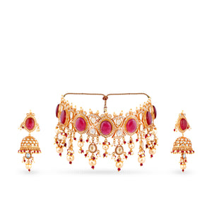 High end finish gold plated kundan choker and earrings set with synthetic polkis cladded in pure silver casing centered with Hydrothermal ruby and faux pearl drops.