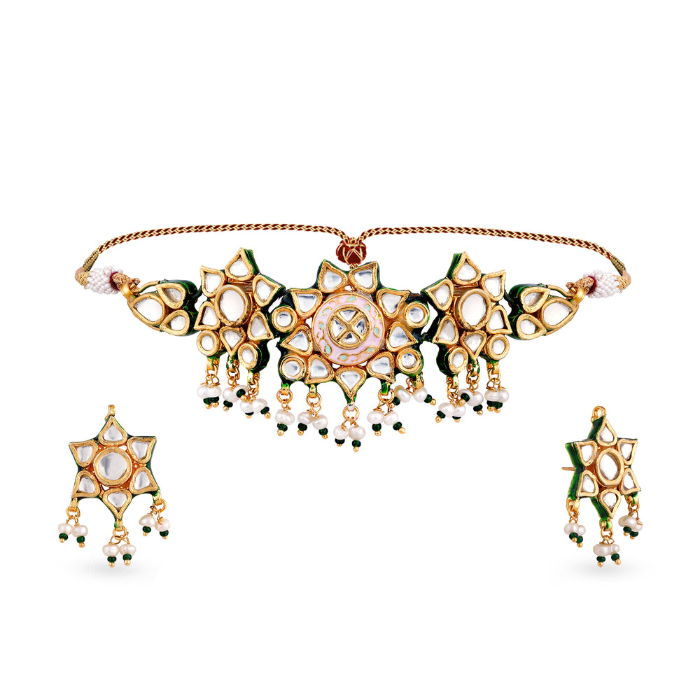 Gold plated silver mix base metal kundan choker and earrings set with real pearls and pink meena work. The set has handpainted meenakari work at the back of the set.