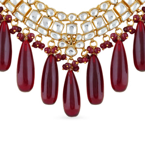 Gold plated kundan necklace with matching earrings,