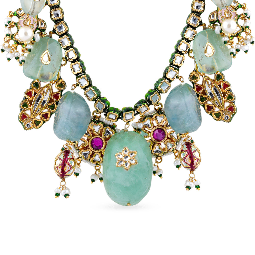 Gold plated silver mix base metal kundan necklace and earrings set with real pearls and Fluorite . The set has hand-painted meenakari work at the back.