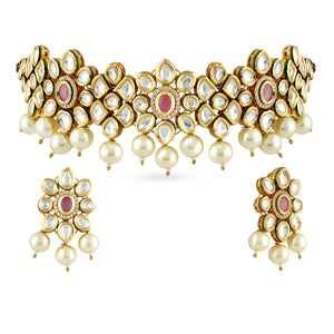 A beautiful choker set in gold plated kundan stones with matching earrings and tikka.