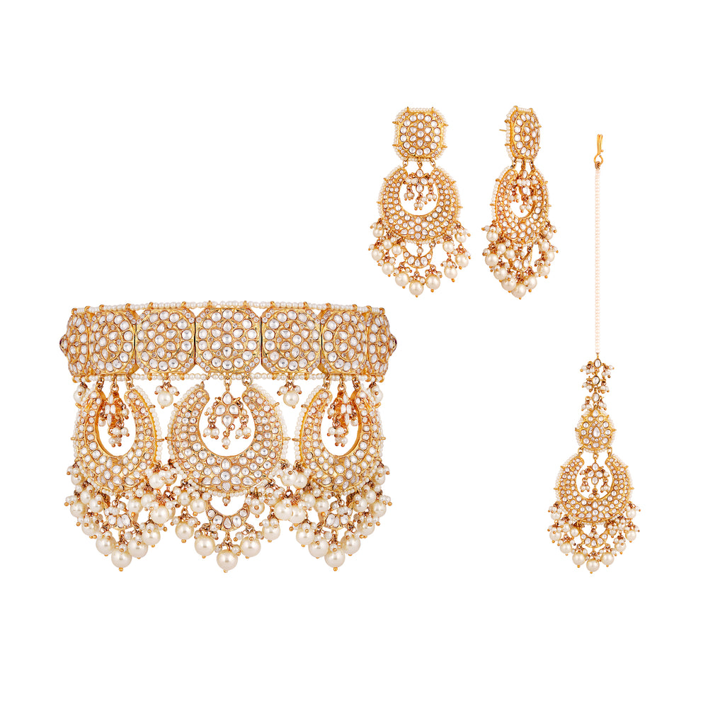 Gold plated kundan bridal choker with matching earrings and tikka.