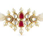 Gold plated kundan choker set with red center and faux pearl.