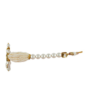 Gold plated kundan choker set with cubic zirconia outline and faux pearl.