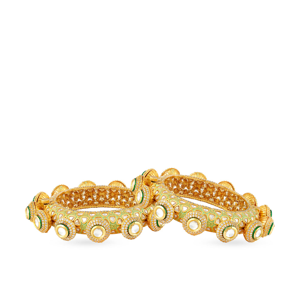 Gold Plated kundan and green meenakari work statement kada with cubic zriconia outline.
