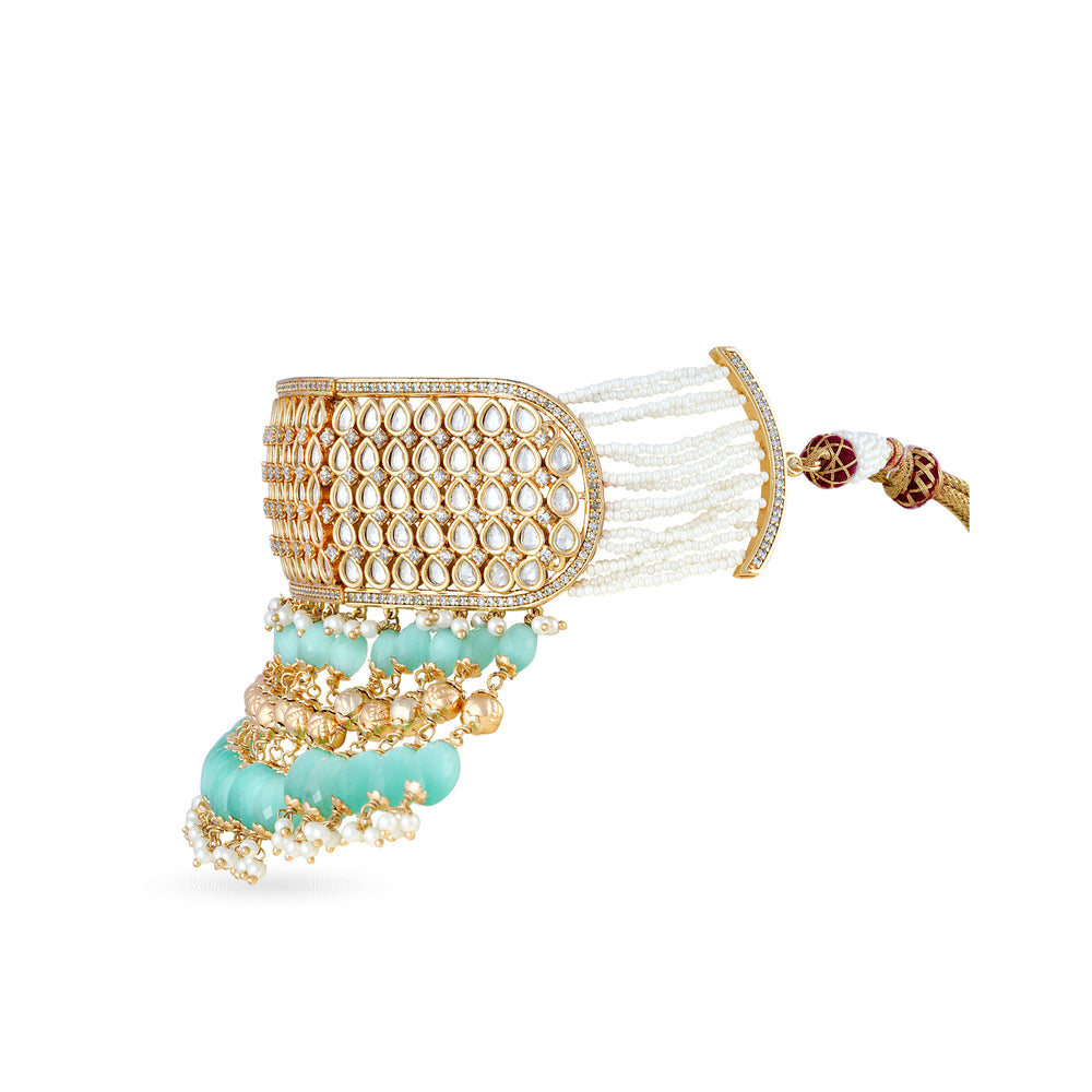 Gold plated kundan and zirconia stone choker with faux pearls.