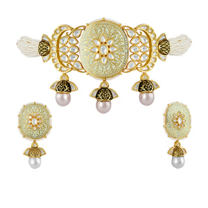 Kundan and meenakari choker with matching jhumki earrings.Kundan and meenakari choker with matching jhumki earrings.