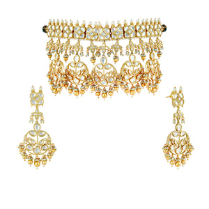 Gold plated kundan choker necklace set with matching earrings.