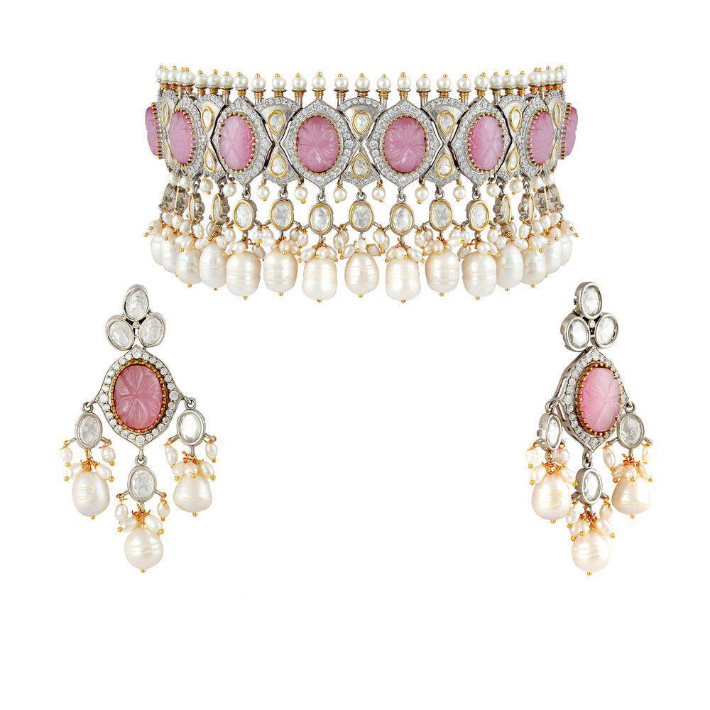 Rhodium plated kundan and zirconia choker set with pink carved center stone and faux pearl details.