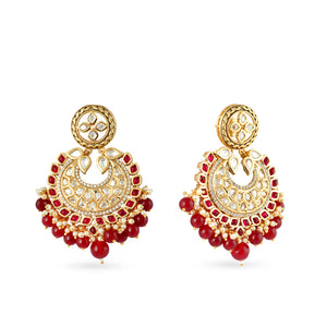 Gold plated kundan necklace set with matchng earrings and red drops.