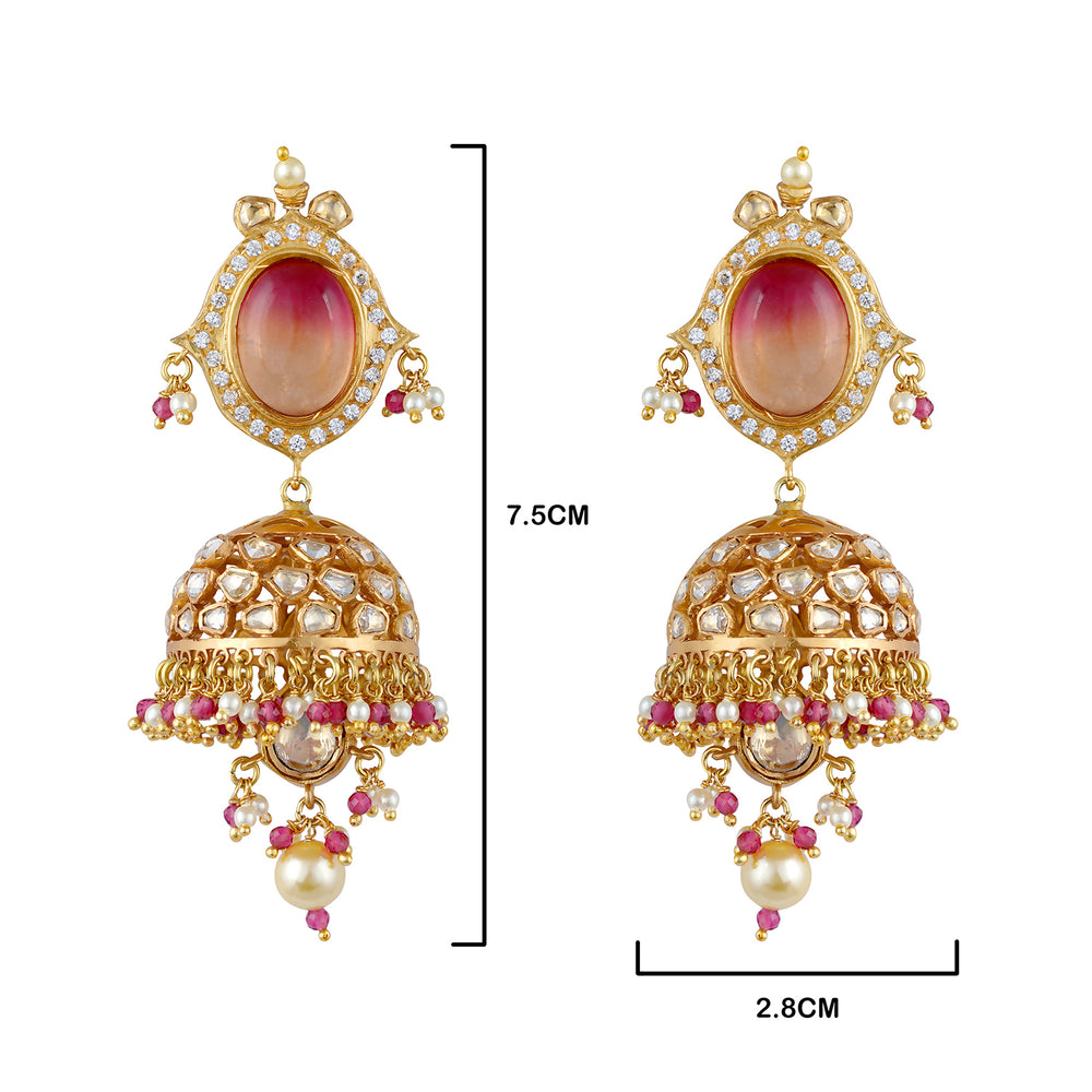 High end finish gold plated kundan choker and earrings set with synthetic polkis cladded in pure silver casing centered with Hydrothermal pink fade and faux pearl drops.
