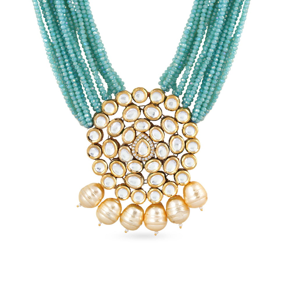 Gold plated long haar with blue beads and kundan pendant.