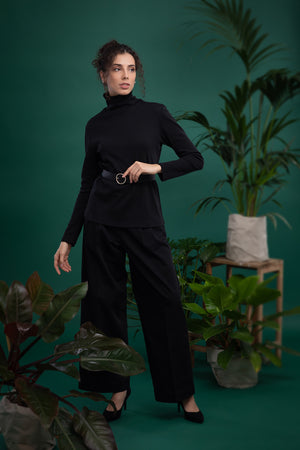 A model in black ecological turtleneck - Dolce Vita and black eco trousers. Ethical and sustainable ECO fair fashion