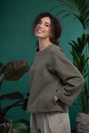 A model in olive ecological smock. Ethical and sustainable ECO fair fashion