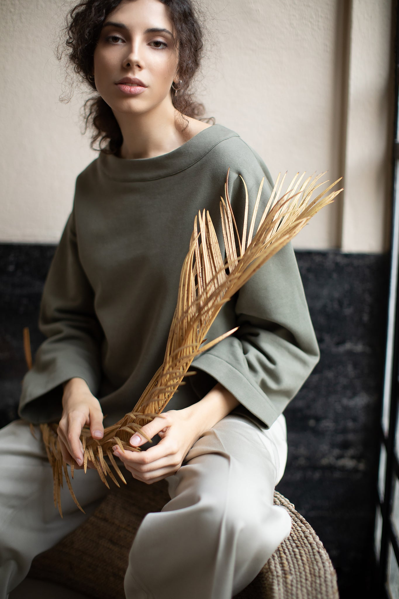 A model in olive ecological smock - CARMINE. Ethical and sustainable ECO fair fashion