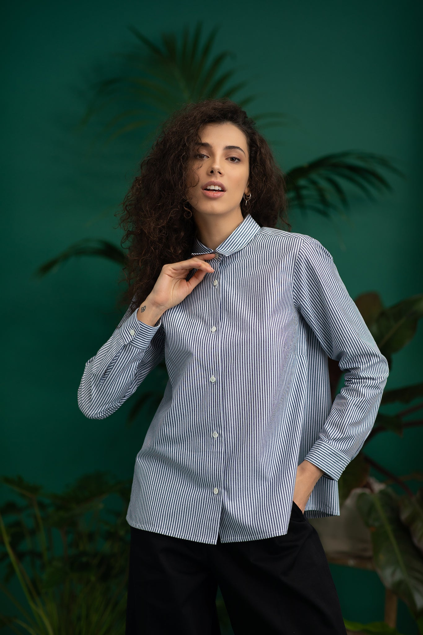 A model in striped white-blue ecological shirt - MILANO. Ethical and sustainable ECO fair fashion