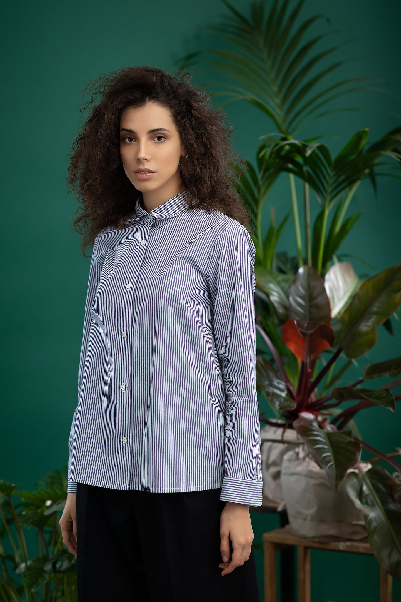 A model in striped white blue ecological shirt - MILANO and black eco trousers. Ethical and sustainable ECO fair fashion