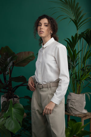 A model in white ecological shirt - MILANO and beige eco trousers. Ethical and sustainable ECO fair fashion
