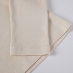 Beige eco turtleneck. GOTS certified textile. 100% natural. Sustainable fashion.