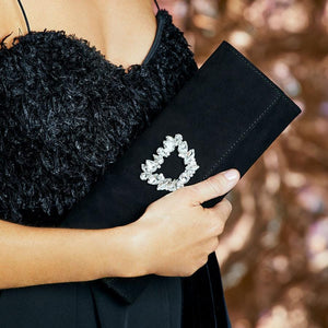 Luxurious black suede clutch bag for special occasions