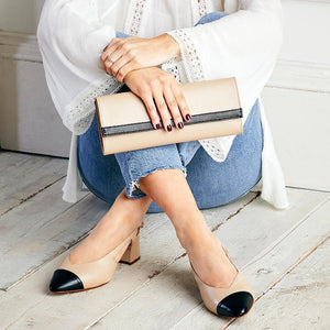 Black and nude leather clutch bag with matching bunion heels by Sole Bliss