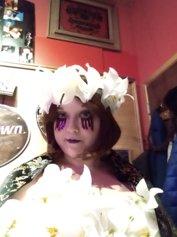 The artist in lily costume