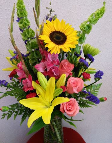 sunflower bouquet bells of ireland pink oriental lily bouquet pink rose bouquet chicago il flower delivery florist in 60634 60647 same day flowers order flowers online chicago