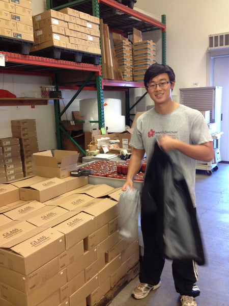 Our first pallet of ketchup, building in progress… Xiao you look handsome