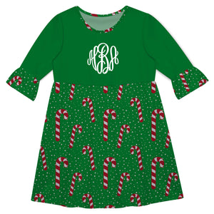 Green three quarter sleeve Amy dress with all over candy cane print and fancy circle monogram