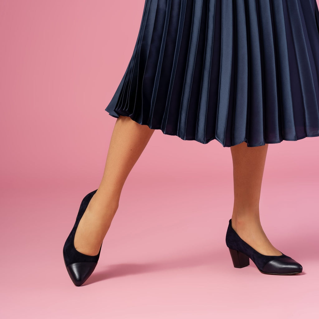 female standing with feet shod in blue heels blueberry small size shoes model from petitfour magnolia collection