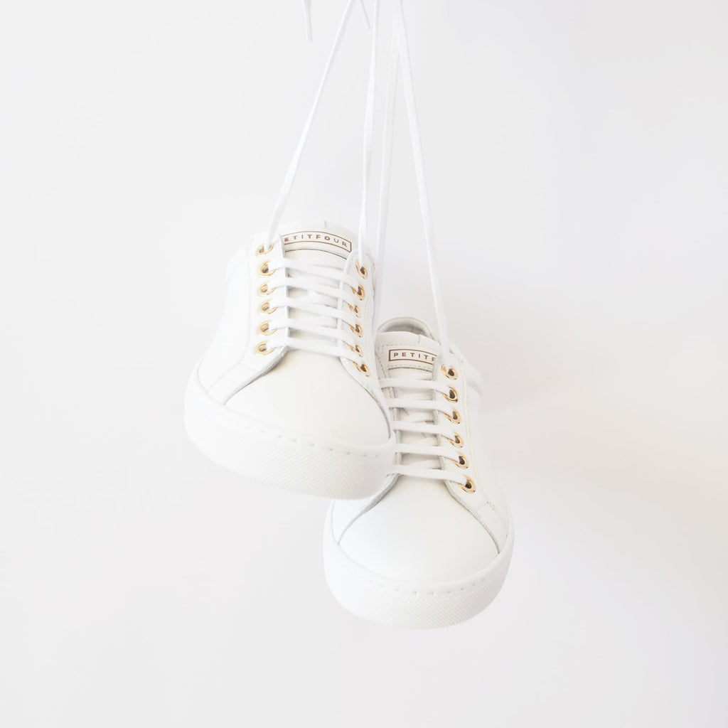 top front view of white sneakers marshmallow small size shoes model from petitfour feeling good collection