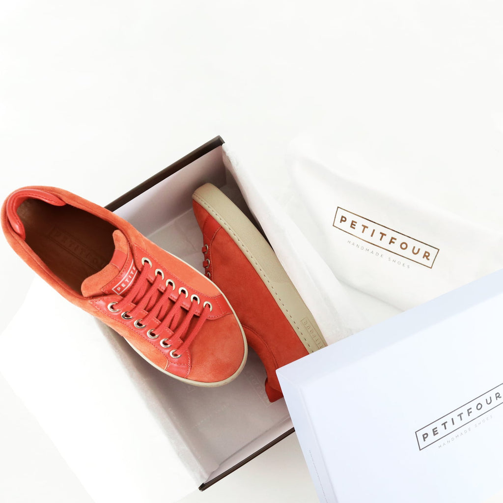 top and side view of orange sneakers papaya small size shoes model from petitfour feeling good collection