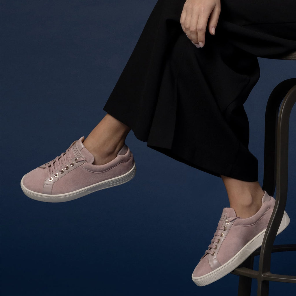 female seated down with feet shod in pink sneakers turkish delight small size shoes model from petitfour feeling good collection