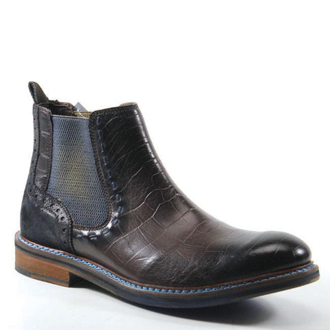 You will want to do a double-click when you see the CLICK ONE boots by Testosterone Shoes. These slip-on shoes offer a subtle crocodile pattern, accent stitching on the sole, side gore for a secure fit, and easy pull tab. The unique design of these boots complements casual and dressier looks.