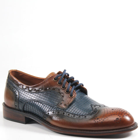 Our hats are off to this dapper shoe by Testosterone. The VAIL YOU oxford features a wingtip, lace-up design with decorative broguing on the cap toe. The burnished leather upper provides a handsome, vintage effect that will help you stand out when it's time to dress up.