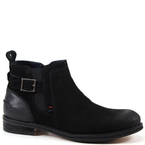 This Testosterone shoe stands out from your everyday urban street shoe. This shoe offers a distressed, worn look by darkening the color around the toe and vamp. A side zipper allows for easy accessibility and a lycra panel allows for stretch and leeway. A bold wraparound strap with buckle along the upper tops off this shoe.