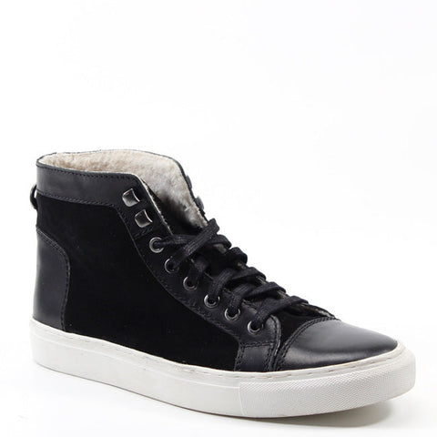 Sneakers never looked so hip than with the Too Day by Testosterone. This high-top shoe features a white sole and a shearling lined interior. Leather and canvas paneling and a lace up front, make this a grown up version of your favorite sneaker style.