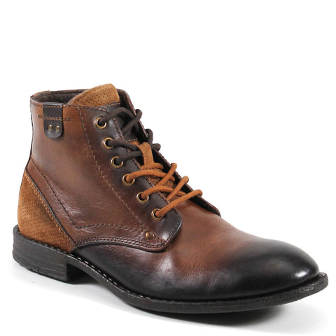 This iconic rugged, stylish boot called FIGHT SONG by Testosterone®  crafted out of robust and durable leather with a stacked heel and classic welt construction.  A lace up vamp compliments strategically placed antiquing in a sharp silhouette that looks great with everything.