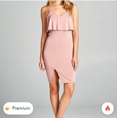 This stylish sleeveless dress features a ruffle detail and side slit is perfect for a party! Model is wearing a size Small