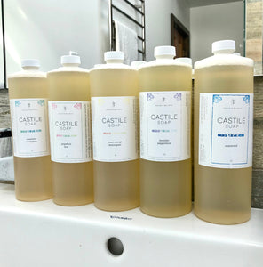 Row of 1L Castile soap bottles in 5 different scents