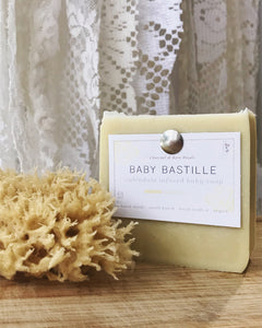 Baby Bastille Soap beside sea sponge