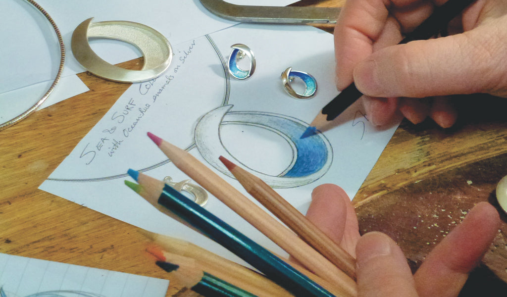 Sheila Fleet sketching designs for her Sea and Surf collection