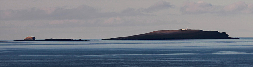 The lighthouse on Copinsay, with the Horse of Copinsay in the distance, two uninhabited islands off Orkney's East Mainland (Photo: Rick Fleet)