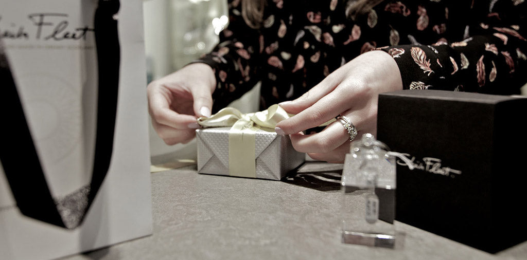 Gift wrapping your jewellery by hand.