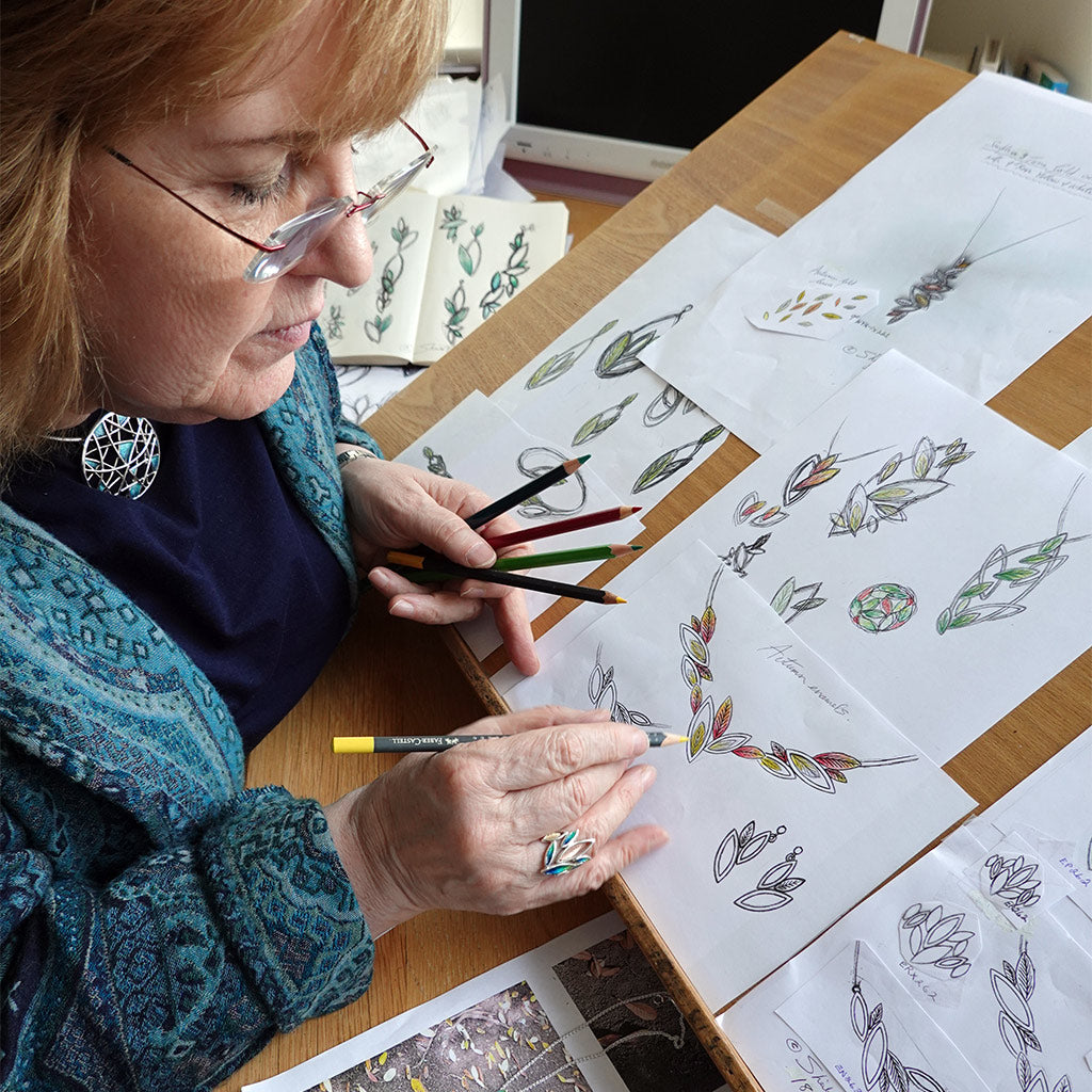 Sheila Fleet sketching designs for her Seasons collection.