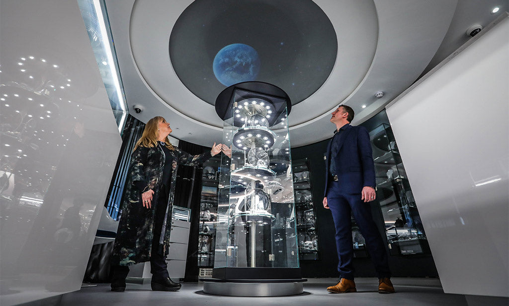 Sheila Fleet and son, Martin, with the gallery's planetarium