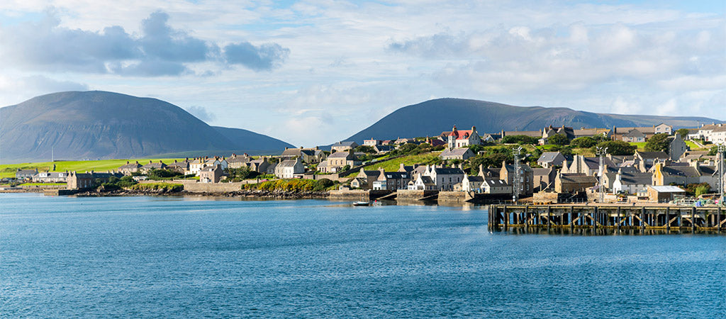 The town of Stromness with the Hoy Hills in the background (Photo: VisitScotland / Kenny Lam)