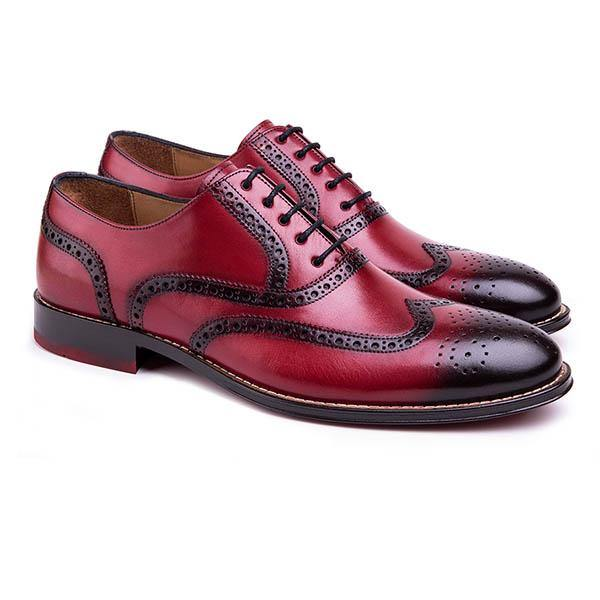 A Fully hand painted leather oxford finished with handcrafted details and shadow effect. The unique red color  wingtip brogue design presents a very stylish look for fashion lovers